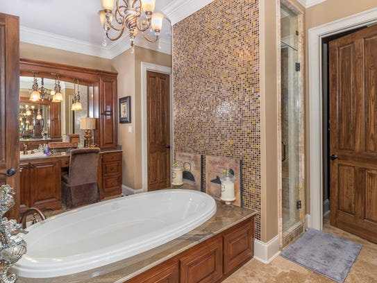 The luxurious master bath has his and her everything.