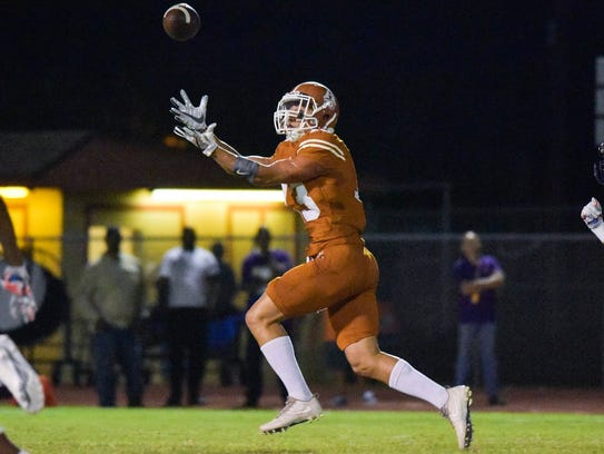 Alice receiver Orlando Espinoza caught five passes for 157 yards and three touchdowns as the Coyotes offense exploded for 41 points in a big win over Miller.