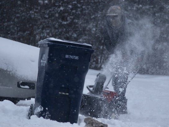 William Lundy of Irondequoit clears a neighbor's driveway