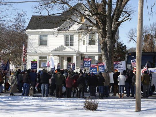 Protestors gather outside Iowa State Sen. Majority