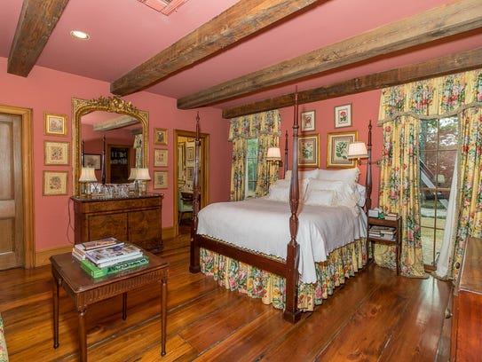 The bedrooms are large and feature gorgeous wood flooring.