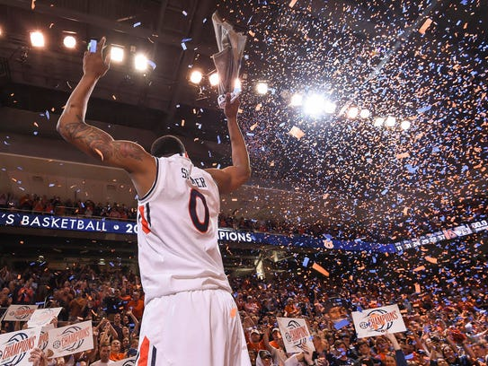 Auburn forward Horace Spencer (0) celebrates the program's