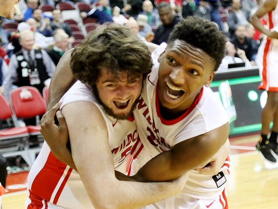 Daniel Daily, left, and Damani McEntire can't contain