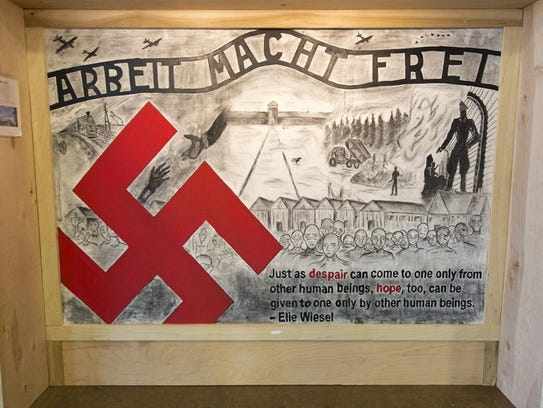 Murals of the Holocaust sit on display at the National