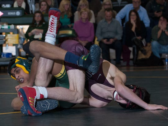 Clearview's Ayush Patel, left, wrestles against Nicholas Gallicchio from Toms River South during the113 lb match in the Sectional Finals at Clearview High School.