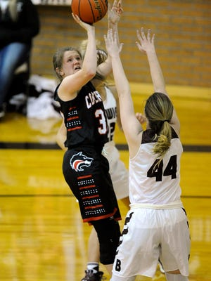 Colorado City's Conley Niblett (33) puts up a shot over Bowie's Madison Hill (44) during the second quarter of Colorado City's 54-43 loss in the Region I-3A quarterfinal playoff on Tuesday, Feb. 21, 2017, in Cisco.