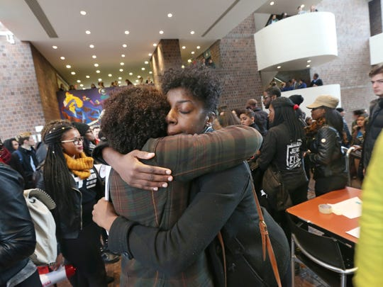 Charlisa Goodlet, president of the Douglass Leadership House, right, is hugged by fellow student Kristin Hocken, inside Wilson Commons following their protest at the University of Rochester Friday, Nov. 20, 2015.   Students were marching to show support for the University of Missouri students, and to urge the UR to address the concerns of minority students on the Rochester campus.