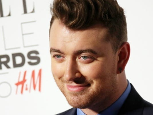 Sam Smith poses for photographers upon arrival at the Elle Style Awards on Feb. 24 in London.