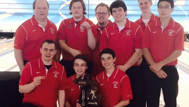 The Division 1 boys bowling regional team champion Canton Chiefs include (kneeling, from left) Josh Criscenti, Jacob Peltz, Dominic Dimaya; (standing, from left) head coach Karl Brubaker, Aaron Madsen, Dave Madsen, Tyler Pozan, Mitchell Zelenak and Teddy Lang.