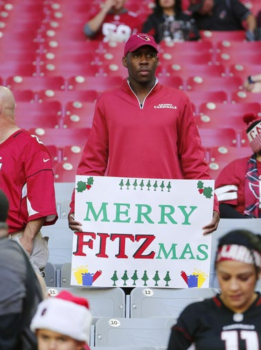 Arizona Cardinals fans watch warmups before a game against the New York Giants at University of Phoenix Stadium in Glendale, Ariz. December 24, 2017.