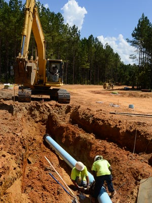 A new water main is put in at Pike Road on Tuesday.