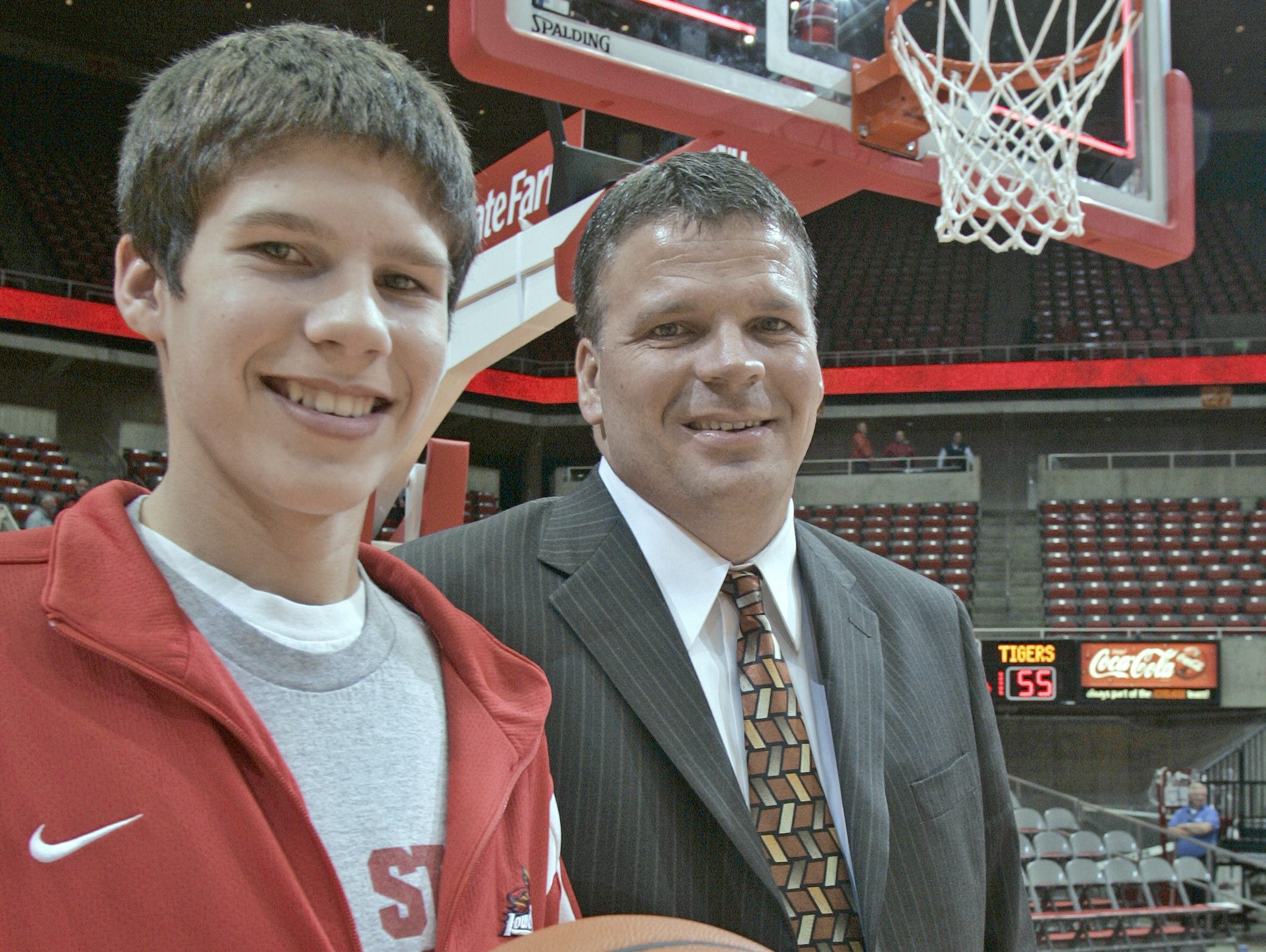 Doug McDermott,15, left, with his father, former Iowa State head men's basketball coach Greg McDermott, on the basketball court at Hilton Coliseum in Ames following ISU's win over Texas Southern on Dec. 19, 2007.