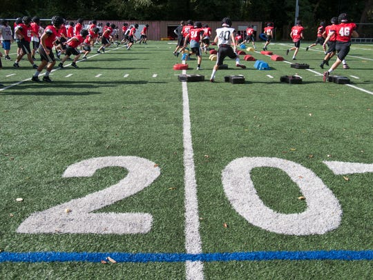 The Haddonfield High School football team practices