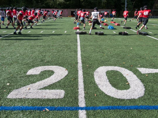 The Haddonfield High School football team practices on a practice field at the school on Wednesday.  The team is playing all of its games away from home this season while the the bleachers at the school's stadium are repaired.  09.27.17