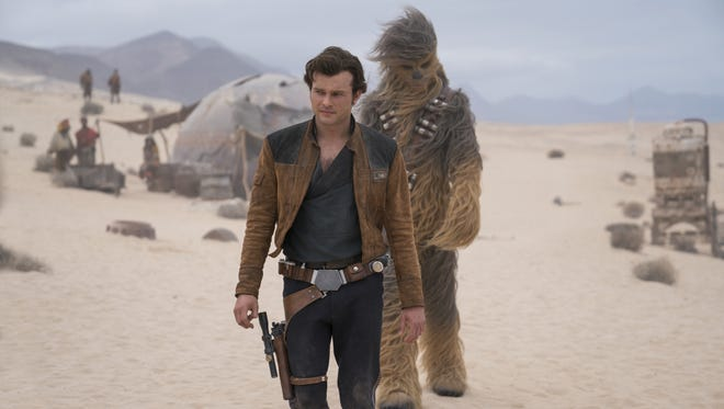 """Young Han Solo (Alden Ehrenreich) goes on his first mission with new pal Chewbacca (Joonas Suotamo) in """"Solo: A Star Wars Story"""" (May 25)."""