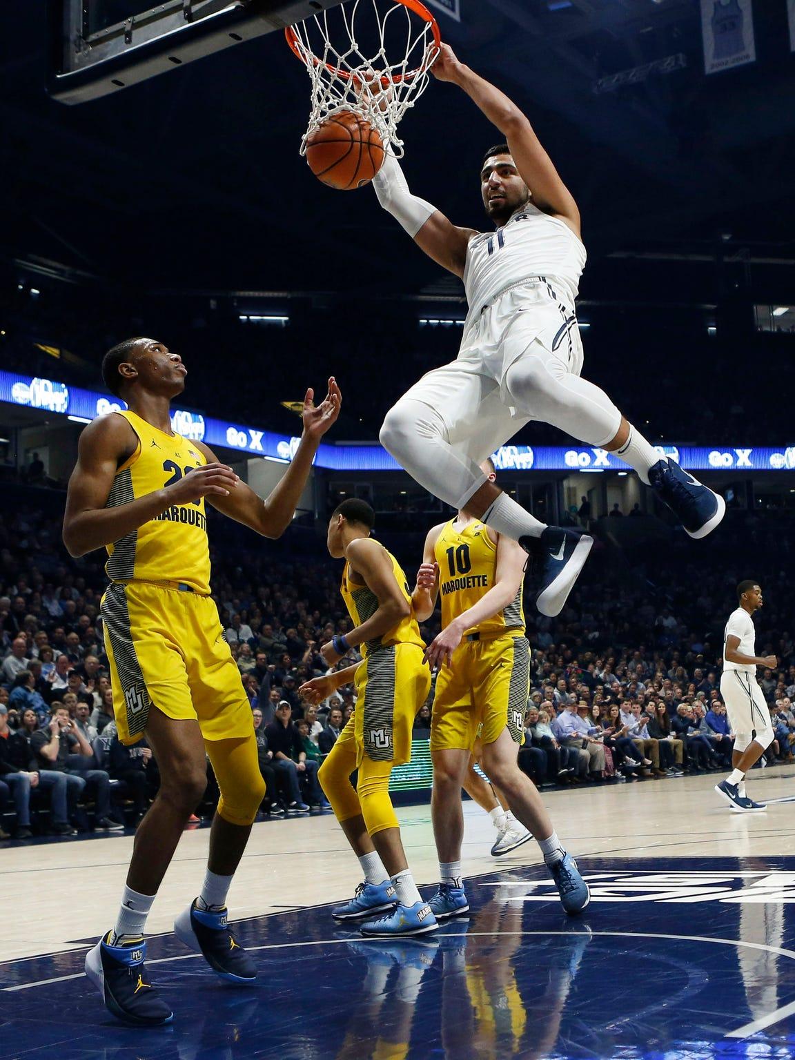 Xavier forward Kerem Kanter throws down a dunk against Marquette in the first half.