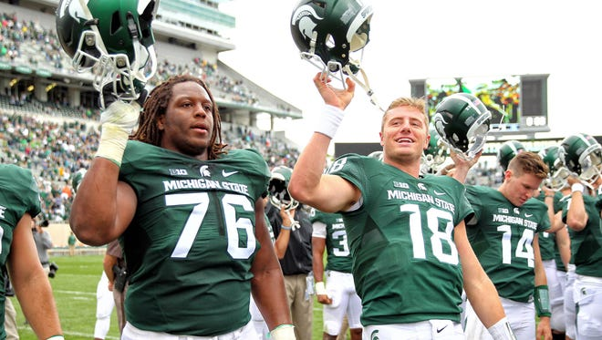 Former MSU offensive lineman Donavon Clark (76) and quarterback Connor Cook (18) signed their first NFL contracts Monday. Cook was a fourth-round pick of the Oakland Raiders, and Clark was a seventh-round selection of the San Diego Chargers.