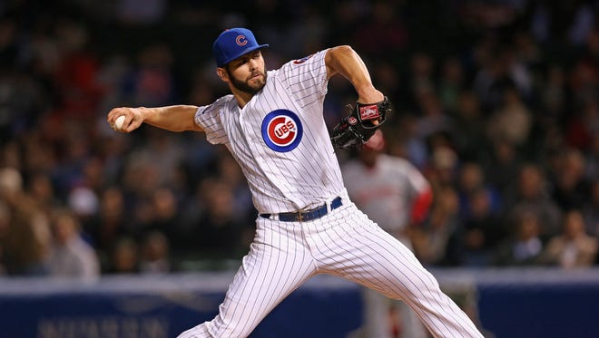 Starting pitcher Jake Arrieta #49 of the Chicago Cubs delivers the ball against the Cincinnati Reds at Wrigley Field on September 16, 2014 in Chicago, Illinois.
