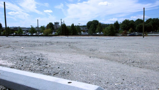 A new gravel lot across from Asheville Regional Airport will be for employee parking, freeing up parking near the terminal for travelers.