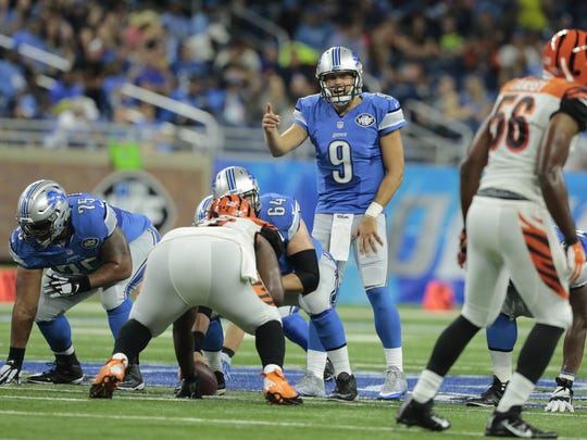 Lions quarterback Matthew Stafford makes a pre-snap adjustment in a preseason game against the Cincinnati Bengals. The Lions are facing the Colts today.