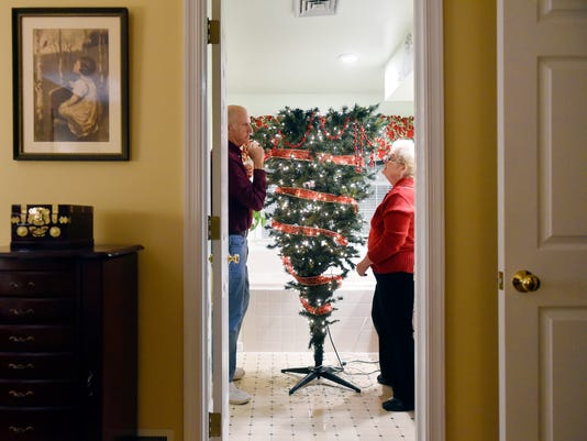 tree toppers couple decorates 24 christmas trees