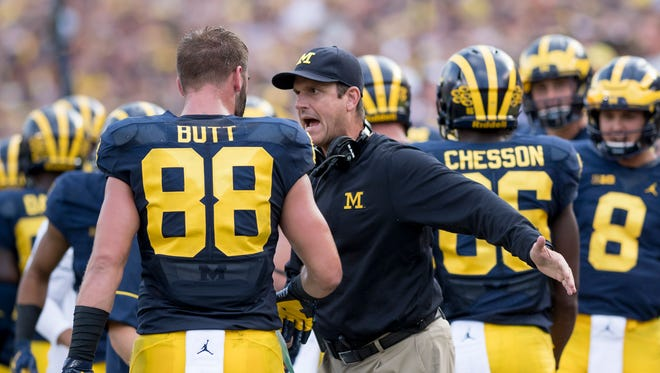 Jim Harbaugh and Jake Butt