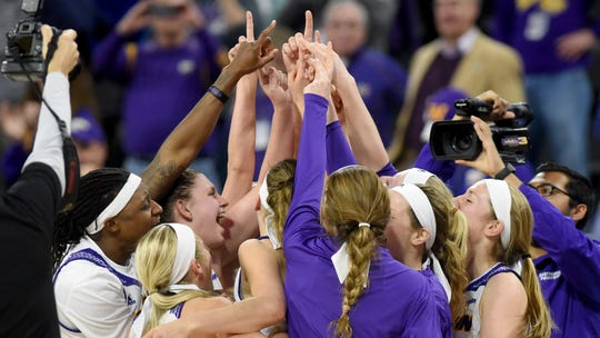 Western Illinois celebrate their victory over IUPUI