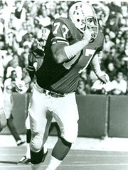 Tom Neville played tackle for the Patriots.