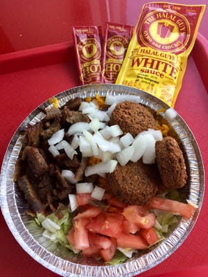 Gyro beef and falafel combination platter.