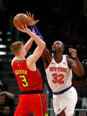New York Knicks forward Noah Vonleh (32) blocks a shot by Atlanta Hawks guard Kevin Huerter (3) during the second half of an NBA basketball game Thursday, Feb. 14, 2019, in Atlanta. New York won 106-91. (AP Photo/John Bazemore)