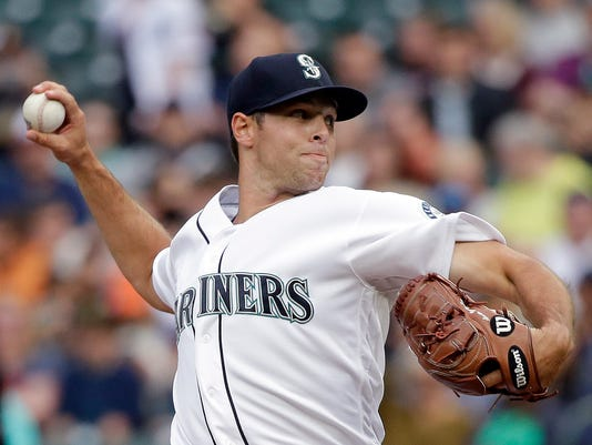 Seattle Mariners starting pitcher Sam Gaviglio throws against the Detroit Tigers in the first inning of a baseball game Monday, June 19, 2017, in Seattle. (AP Photo/Elaine Thompson)