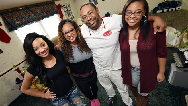 """J.J. Williams, second from right, and his daughters, Sunjai, from left, Star and Sky are enjoying the holidays at their Clinton home and gearing up for the season premiere of the popular Lifetime reality show """"Bring It."""""""