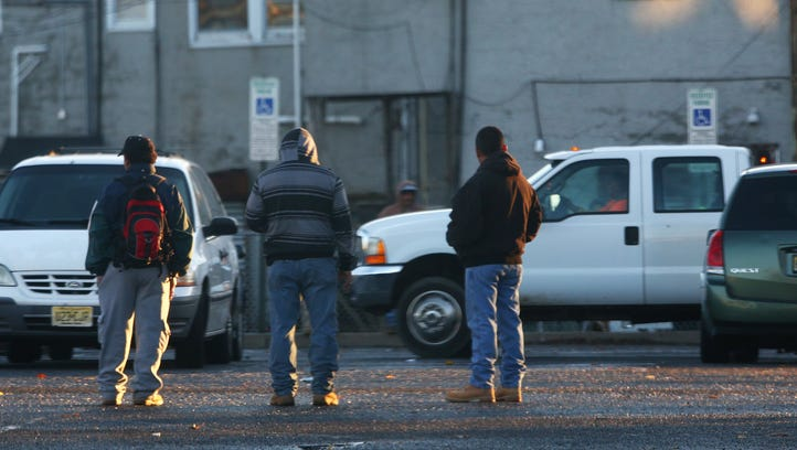 Day Laborers wait and hope to find work from contractors,