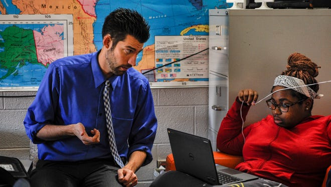 Teacher Jake Habegger  helps Trenyce Turner with her studies in the 8th grade social studies class  at the Freedom Middle School in Franklin, Tenn., Thursday, March 2, 2017.