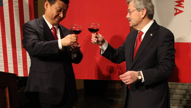 Gov. Terry Branstad, right, and China's then-Vice President Xi Jinping toasted their friendship at a dinner during Xi's visit to Iowa in February 2012. Xi has since become his country's top leader.