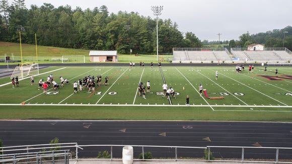 Players on the North Buncombe high school football team run through drills during practice Tuesday, August 15, 2017.