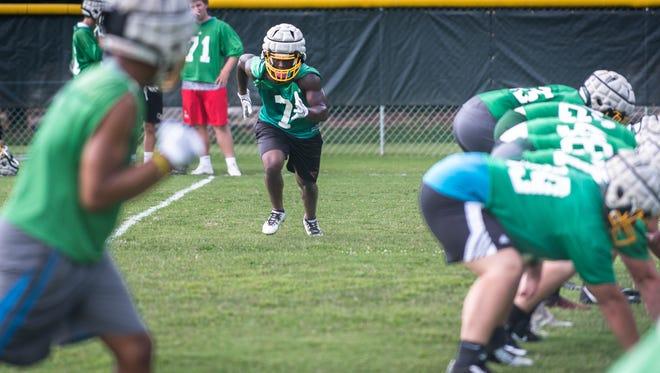 Sidney Gibbs of Christ School  runs through drills during practice Aug. 22.