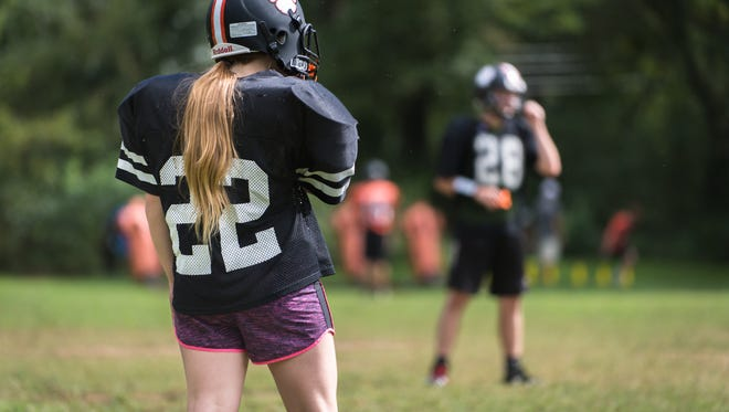 Madison Fischer, a defensive linebacker and runningback on the Rosman High School football team, runs through drills during practice Tuesday, August 29, 2017.