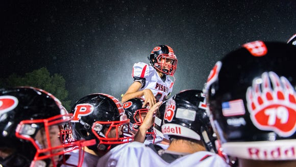 The Pisgah Bears football team celebrates after their