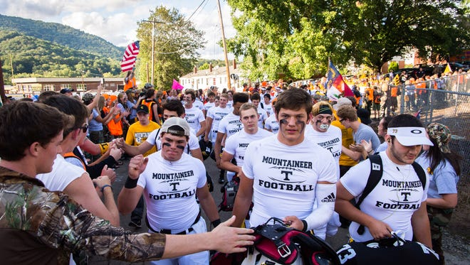 The Tuscola football team is greeted as they arrive for their game against rival team Pisgah last year. The Mountaineers look to break a five-game losing streak to the Black Bears this Friday.