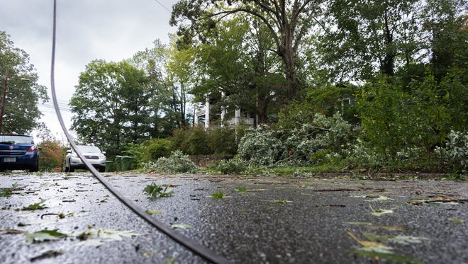 Overhead power lines are more prone to damage, but they're also easier to repair than buried lines, Duke Energy says. This power line on Cumberland Avenue in Asheville went down during a storm in September 2017.