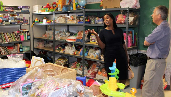 The toy room at Christian Service Center caught Star Parker's fancy during her tour of the facility Tuesday with director Jim Clark. The journalist was the speaker at the organization's 50th anniversary event that evening.