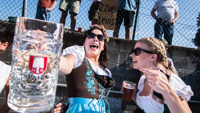 Kelsey Williams, of Chattanooga, Tennessee, struggles to hold up a stein filled with water during their stein hoisting competition at the 7th annual Southern Appalachian Brewery Oktoberfest in Hendersonville, Saturday, September 23, 2017.