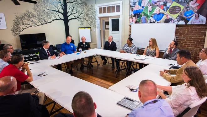 Officials from local agencies in Marion as well as McDowell county gather at Freedom Life Ministries to discuss their work addressing opioid and drug addiction with North Carolina Attorney General Josh Stein Monday, September 25, 2017.