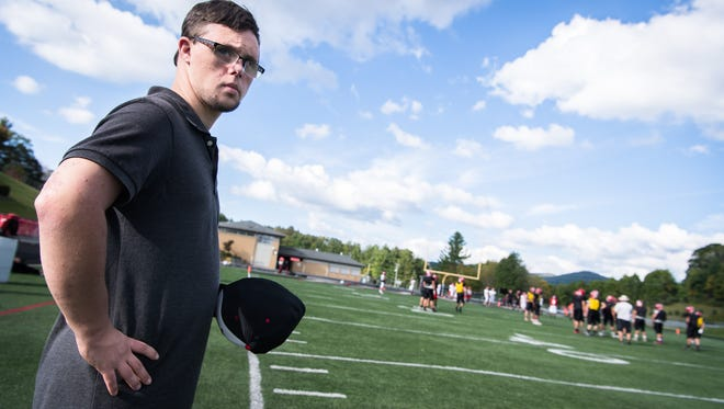 Hunter Goodman, the Avery County High School football team's manager, on the sidelines during practice Tuesday, September 26, 2017.