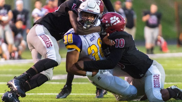 North Henderson's Kai Anthony is tackled by Asheville's
