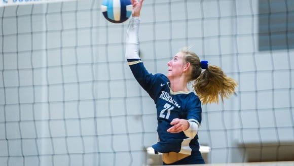 Roberson's Abby Krueger returns a shot to West Henderson