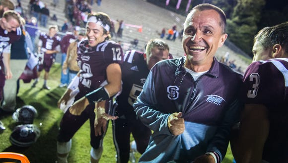 Swain County football head coach Neil Blankenship laughs