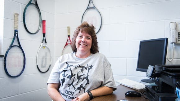 Lisa Laney, Erwin high school tennis coach and dance teacher, in her office. Laney was diagnosed with breast cancer in August of 2014, and after chemotherapy and radiation treatment, she was found found clear of disease in June of 2015.
