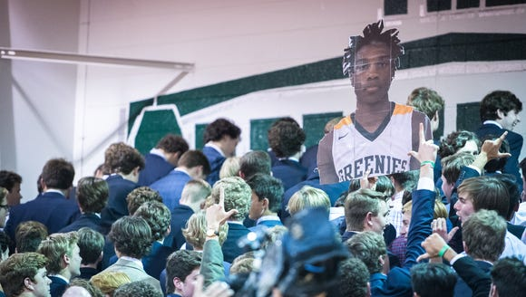 Christ School students turn their backs as the Spartanburg